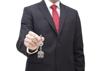 House key in businessman hand with clipping path
