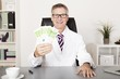 Happy Physician Holding Cash