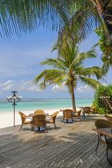 Restaurant on tropical beach next blue ocean