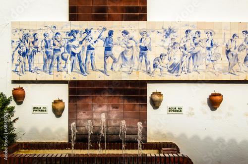 canvas print picture Hauswand mit gemaelde und Brunnen in Benalmadena Spanien