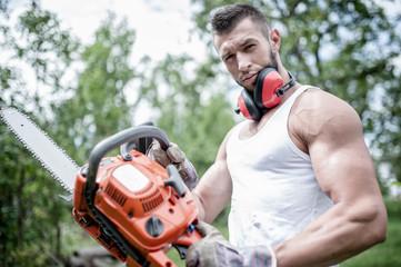 portrait of aggressive muscular male lumberjack, woodworker
