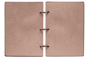 open notebook with pages of brown color