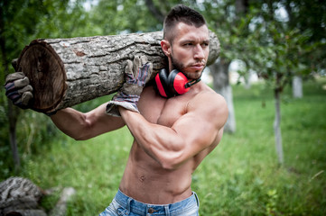 male lumberjack handsome man cutting trees and moving logs