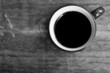 Cup of black coffee  on wooden background.Black and white