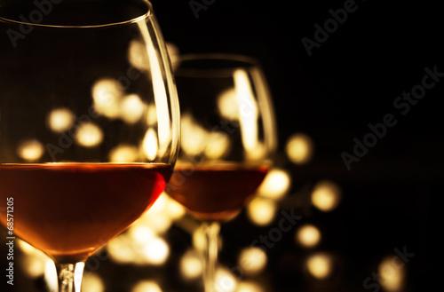 2 Red wine glasses. Christmas romantic dinner image. - 68571205