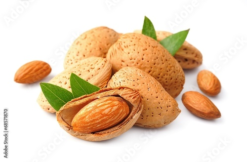 canvas print picture Almonds nuts with leaves