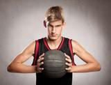 Fototapeta portrait of basketball player on gray background