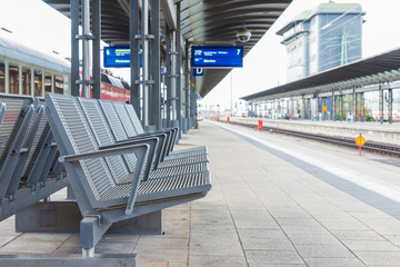 The steel chairs on the platform in train station