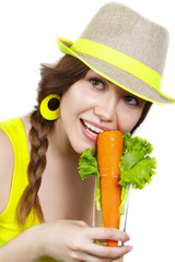 Portrait of beautiful girl with vegetables on white background