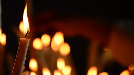 Candle at candlestick in church