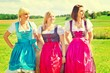 Three girls in dirndl