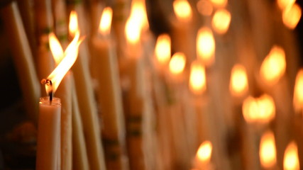 Candles at candlestick in church