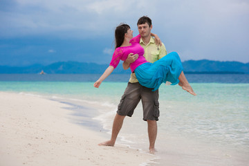 man and woman on a tropical beach