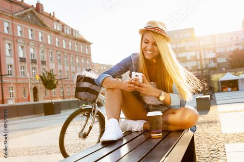 Leinwanddruck Bild Young stylish woman in a city street
