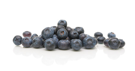 ripe blueberries on a white background with reflection