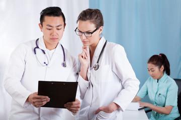 Doctors analyzing documents