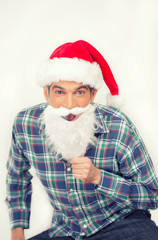 Happy smiling man with shirt and Christmas red hat pretending to