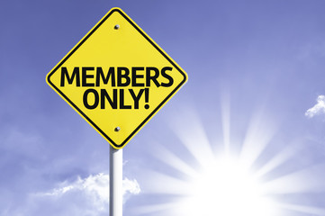 Members Only road sign with sun background