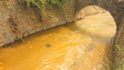 wastewater runs through old sewer canal