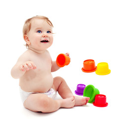 Cute infant boy with toys