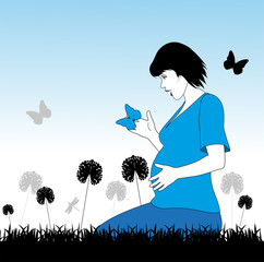 donna incinta in un prato con farfalle