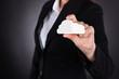Businesswoman Holding Cloud Computing Icon