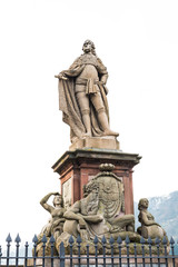 The statue of a man at the old bridge in Heidelberg
