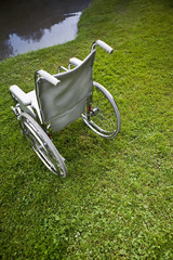 Wheelchair for disabled near a lake