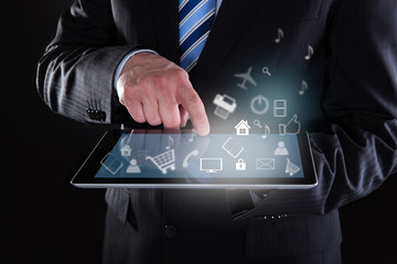 Businessman Using Digital Tablet With Various Icons