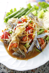 close up thai spicy crab and papaya salad in dish