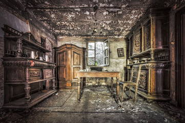 Decayed dining room in an abandoned house