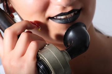 girl and retro telephone