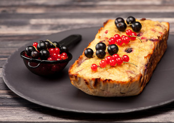 Cake with berries red currant and black currant