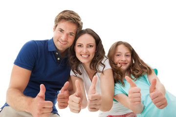 Happy Family Gesturing Thumbs Up