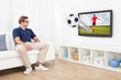 Man In 3D Glasses Watching Football On TV