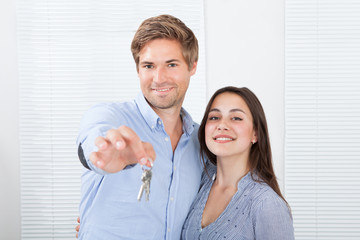 Couple Holding Keys In New House