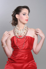 Pretty Red Themed Fashion Model Wearing Lots of Pearls