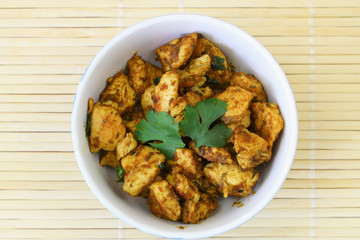 Spicy chicken with curry and coriander