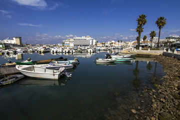 View of a beautiful marina with boats in Faro, Portugal.