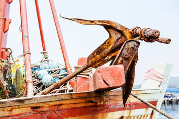 Rusty anchor on the boat