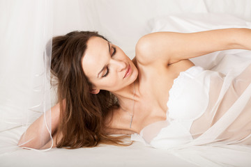 Sensual lady lying in bed