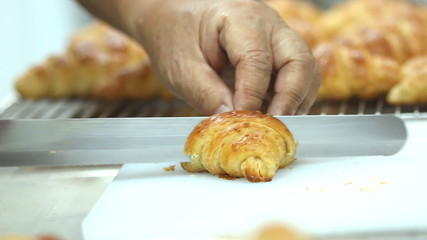 Set collection montage, croissant cutting, kitchen background