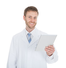 Smiling Male Doctor Using Digital Tablet