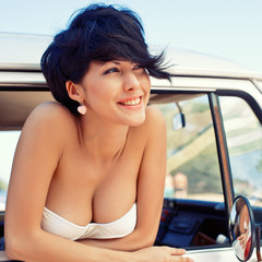 a beautiful young girl with short hair cut and blue eyes