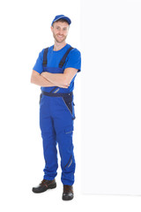 Worker Standing Arms Crossed While Leaning Over White Background