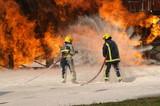 fire crew fighting aircraft fire