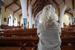 Obrazy na płótnie, fototapety, zdjęcia, fotoobrazy drukowane : woman praying in church from behind