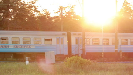 Train at sunset with cool sun beams. Travel concept