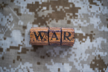 War text on camouflage background