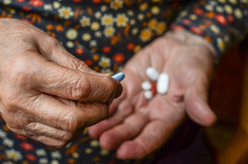 pills on hand of a senior person